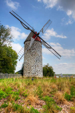 A Vertical of Moulin de Pointe-aux-Trembles, a Stone Windmill from Quebec, Canada. Built 1719 on a French design