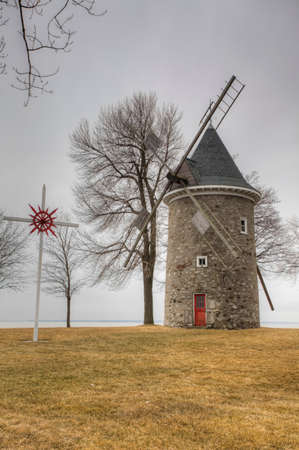 A Vertical of Moulin des Sulpiciens, a Stone Windmill from Quebec, Canada. Built 1709 on a French design Editorial