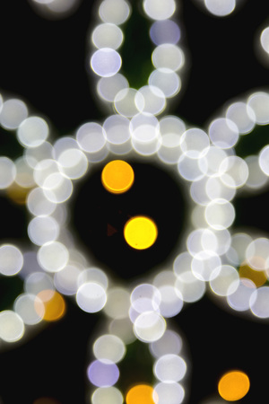 Blurred bokeh city lights to use as a background for concepts like valentines day, christmas, shopping, events, night life etc.