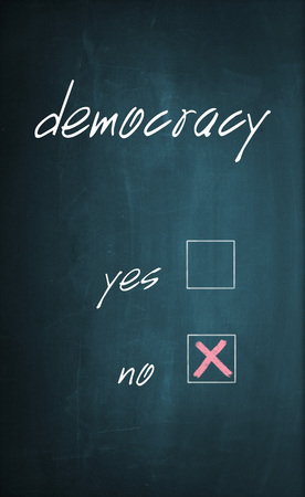 x marks the spot: Conceptual text Democracy written with chalk on a dirty blackboard and no box is selected with red cross sign.