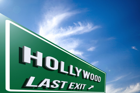 Hi-res 3D highway Hollywood road sign against a blue sky with cloudscape. 3D rendering. Stock Photo