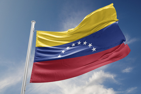 Venezuela flag is waving at a beautiful and peaceful sky in day time while sun is shining. 3D Rendering 免版税图像