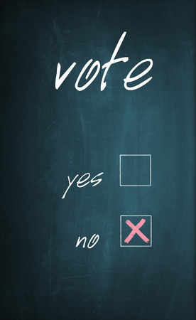 x marks the spot: Conceptual text Vote written with chalk on a dirty blackboard and no box is selected with red cross sign.