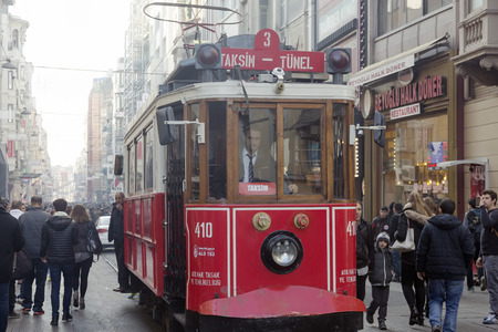 ISTANBUL - DECEMBER 27, 2015: Traditional street car is travelling with passengers to Taksim Square, from Istiklal Street, Istanbul, Turkey. Photographed with Canon EOS 5D Mark III in RAW 16bit.