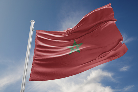 Morocco flag is waving at a beautiful and peaceful sky in day time while sun is shining. 3D Rendering Stock Photo