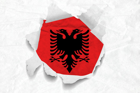 Realistic illustration of Albania flag on torned, wrinkled, dirty, grunge paper. 3D rendering. Banco de Imagens