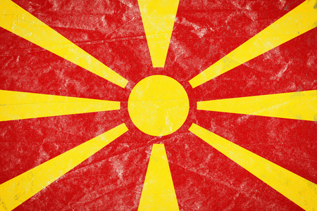 Realistic illustration of Macedonia flag on torned, wrinkled, dirty, grunge paper poster. 3D rendering.