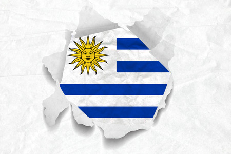 Realistic illustration of Uruguay flag on torned, wrinkled, dirty, grunge paper. 3D rendering. Stock Photo