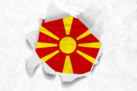Realistic illustration of Macedonia flag on torned, wrinkled, dirty, grunge paper. 3D rendering.