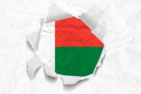 Realistic illustration of Madagascar flag on torned, wrinkled, dirty, grunge paper. 3D rendering.