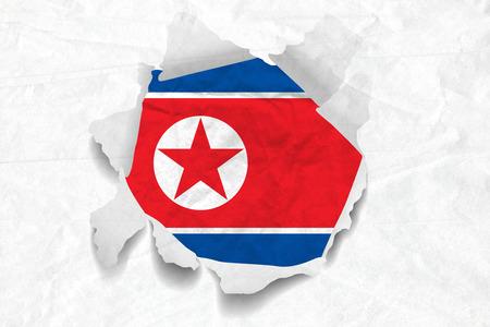 Realistic illustration of North Korea flag on torned, wrinkled, dirty, grunge paper. 3D rendering.