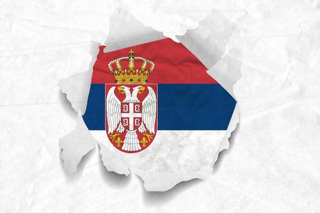 Realistic illustration of Serbian flag on torned, wrinkled, dirty, grunge paper. 3D rendering.