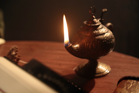 Detail shot of an historic oil lamp with other scientific materials.