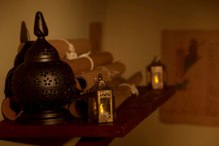 Detail shot of historic oil lamps, sheets and other scientific materials.