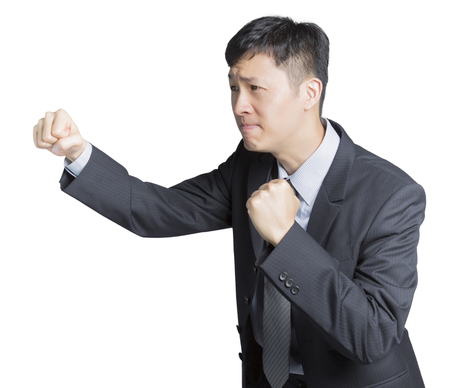 a striving businessman swinging his fists with a melancholic face