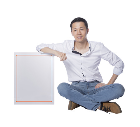 sitting man pointing a big whiteboard to make a report, real photo