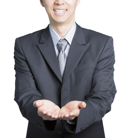front facing: young businessman put his hands to the front, with his palms facing up