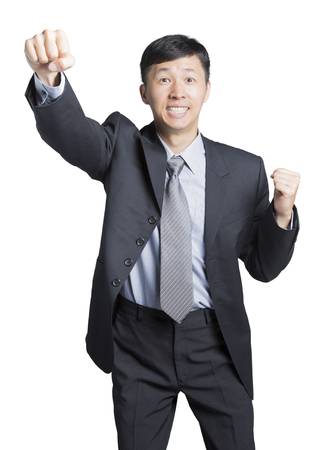 striving: a striving businessman swinging his fists with a joyful face