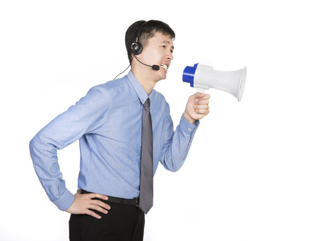 working operator talking through a megaphone, white background Stock Photo