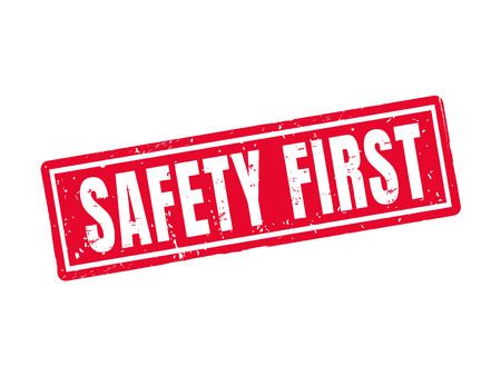 Safety first in red stamp style, white background