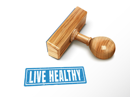 Live Healthy blue text with lying wooden stamp, 3d illustration