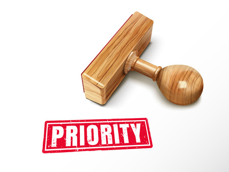 Priority red text with lying wooden stamp, 3d illustration