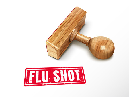 internist: Flu shot red text with lying wooden stamp, 3d illustration