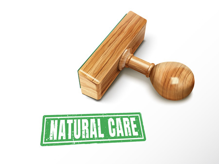 natural care green text with lying wooden stamp, 3d illustration