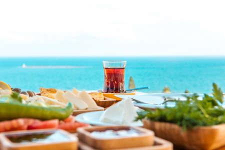 Turkish tea with breakfast on the table.