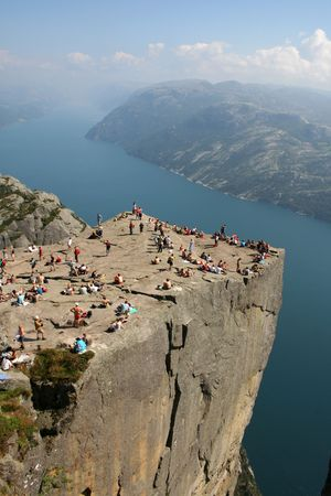 Pulpit Rock at Lysefjorden in Norway. A well known tourist attraction towering 600 meters over sea level. Stock Photo - 844354