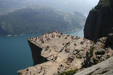 Pulpit Rock at Lysefjorden in Norway. A well known tourist attraction towering 600 meters over sea level.  photo