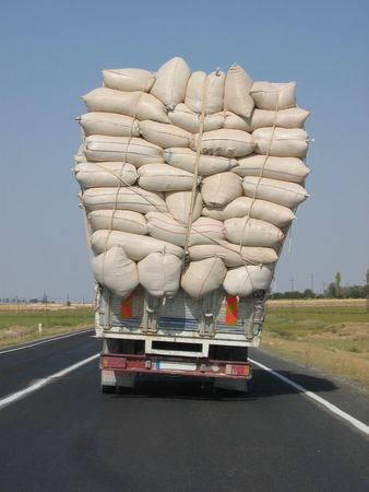 leaning on the truck: Overloaded truck