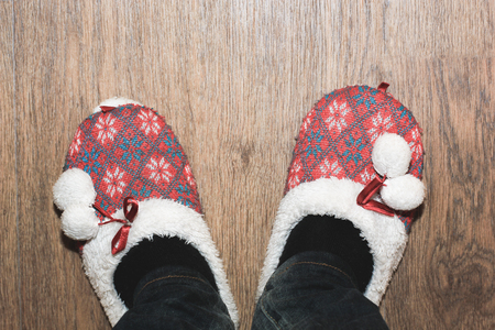 floor cloth: Closeup man feet in cloth slippers on clean wood floor Stock Photo