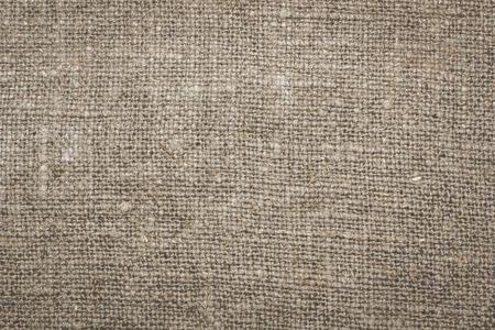 flaxen: a fragment of linen, burlap texture, background