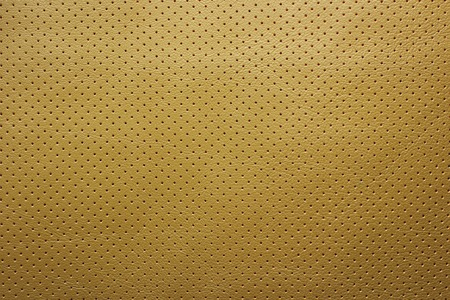 perforated: Yellow perforated leather texture background