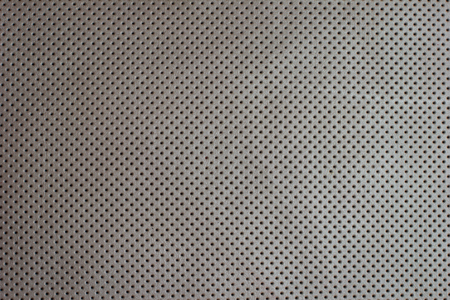 perforated: White beige perforated leather texture background