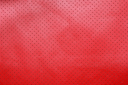 perforated: Red perforated leather texture background
