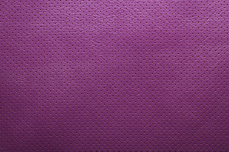 composit: Purple violet perforated leather texture background Stock Photo