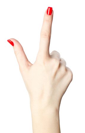 close-up of womans hand with red nails pointing  index finger on white background.