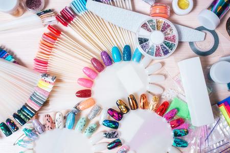 Set of manicure accsessories for nails design. palette tips, colored strips, glitter Banco de Imagens
