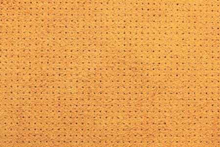 Yellow velvet perforated leather texture background