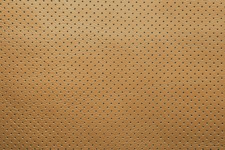 composit: Yellow perforated leather texture background abstract dots