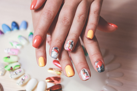 colored manicure on female hand.