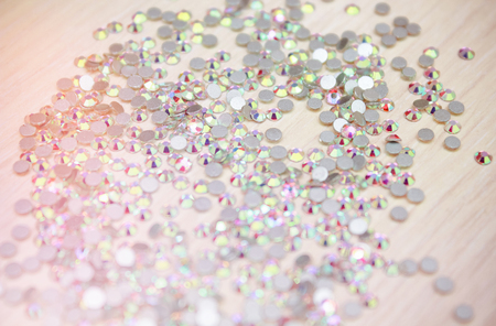 Shiny rhinestones background Close up of a whie all covered with shiny rhinestones Stock Photo