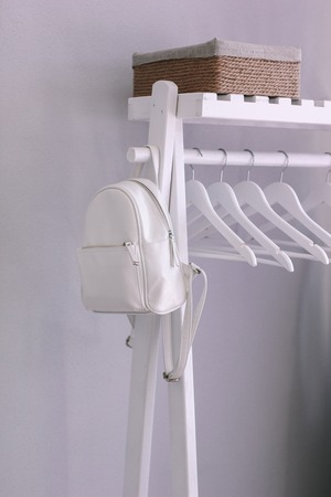 White hanger with white leather backpack and old box Stock fotó