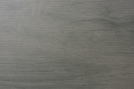 stoneware: A gray floor tile with wooden structure.