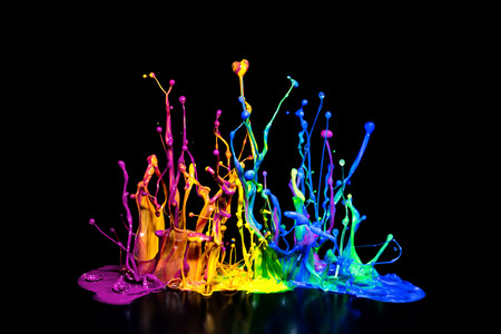 explode: This is a colorful paint splash on a speaker isolated on a black background.
