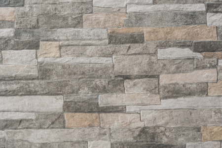 This is a floor tile with a stone wall texture in gray beige Imagens