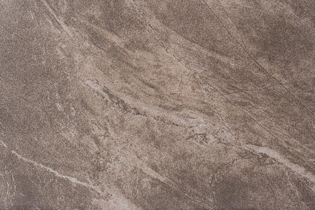 pavimento gres: Si tratta di un pavimento di piastrelle con una texture di marmo marrone. Archivio Fotografico