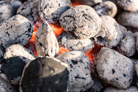 narrow depth of field: Burning coals in a barbecue grill - selected focus, narrow depth of field